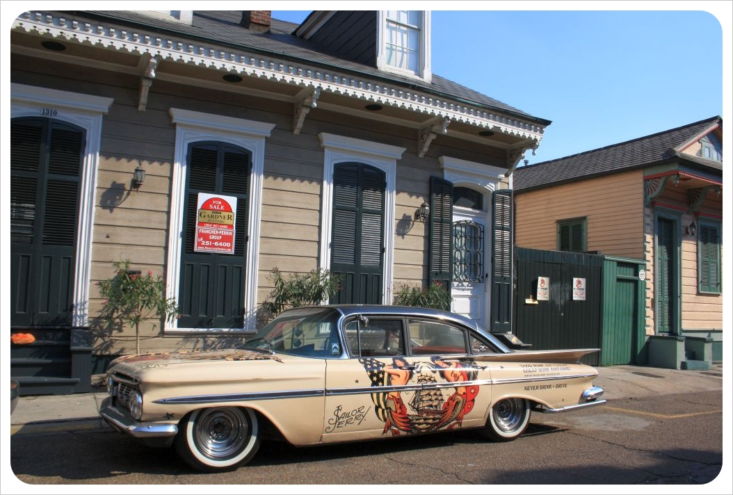 new orleans neighborhood with classic car
