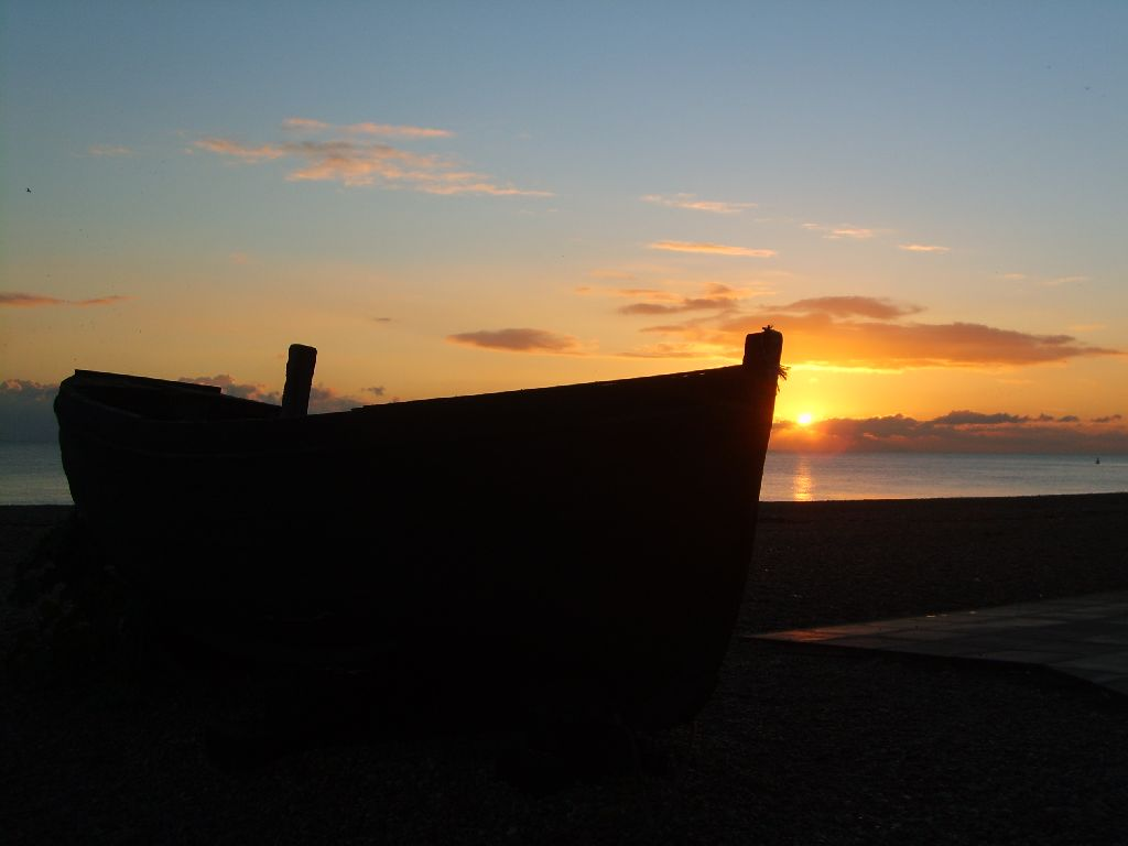 Travel Photo Roulette: Silhouette of a fishing boat from Brighton, England, CA pier. Copyright by globetrottergirls.com