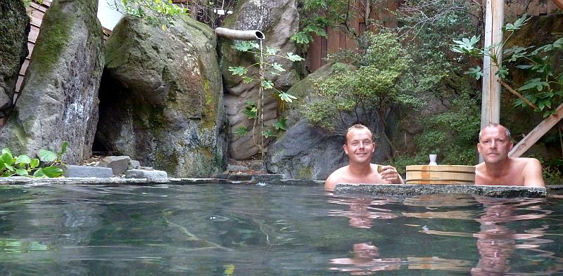 craig and john enjoy sake in japanese onsen